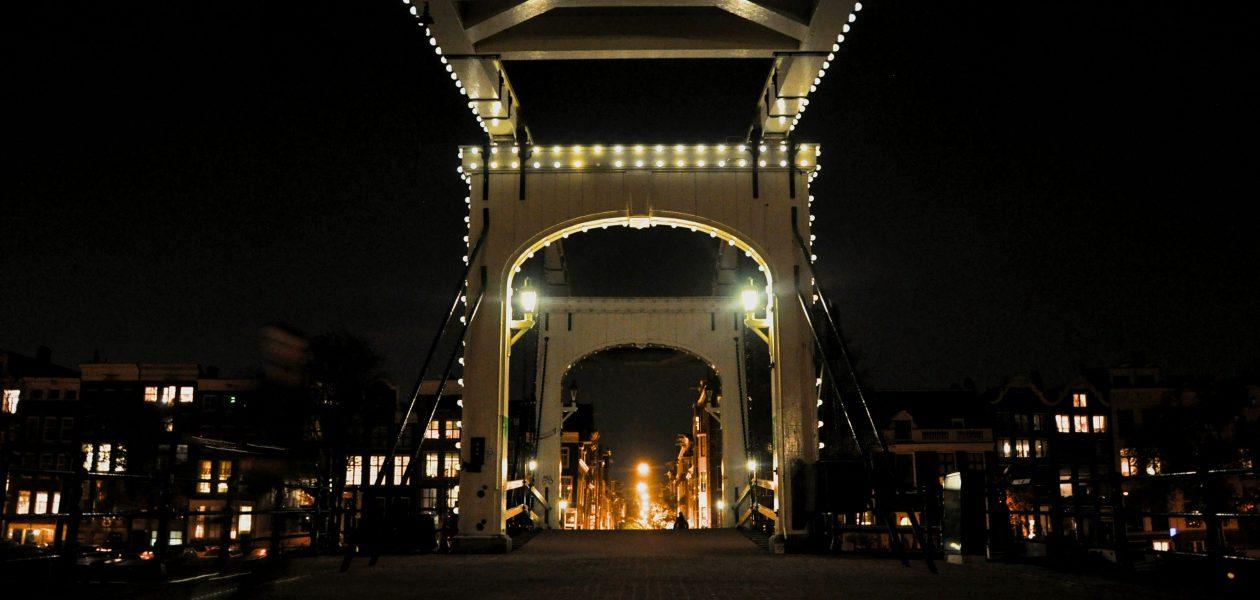 Amsterdam drawbridge at night