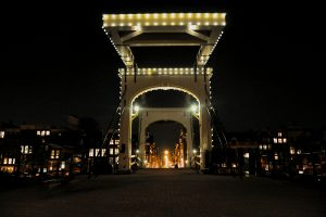 Amsterdam drawbridge at night